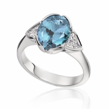 18ct White Gold Oval Aquamarine and trilliant Cut Diamond Ring