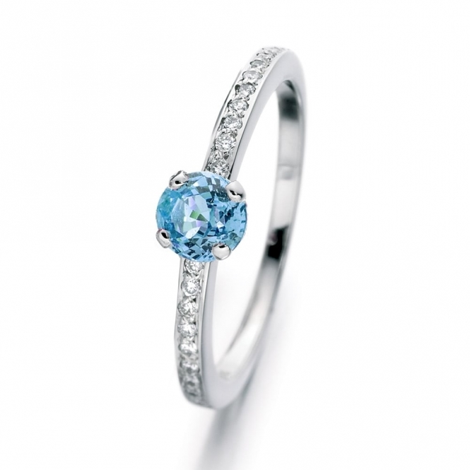 Aquamarine engagement ring with diamond shoulders