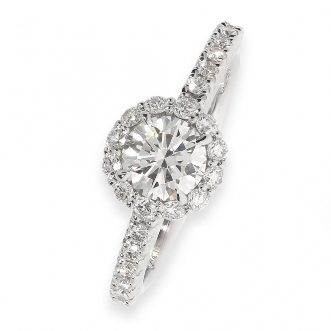 Diamond shoulder halo engagement ring in platinum