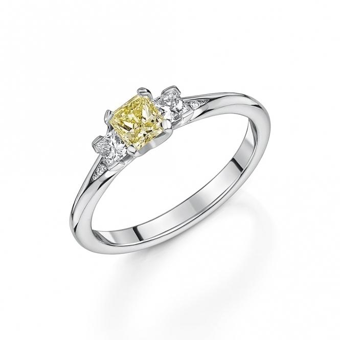 Fancy yellow princess cut diamond three stone ring with diamond set shoulders