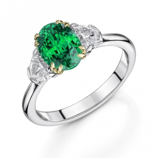 Oval Emerald and Heart Shape Diamond Ring