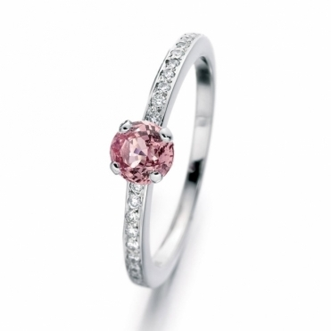 Pink sapphire engagement ring with diamond set shoulders