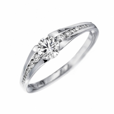 Platinum Diamond Ring with graduated channel set Shoulders