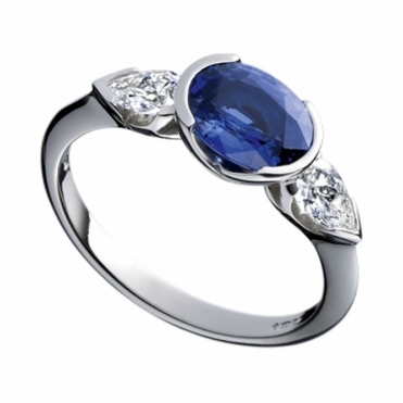 Platinum Oval Blue Sapphire and Pear Shaped Diamond Ring