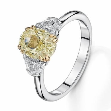 Yellow oval and heart shape diamond three stone ring